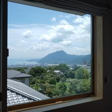 海と山を眺める住まい
